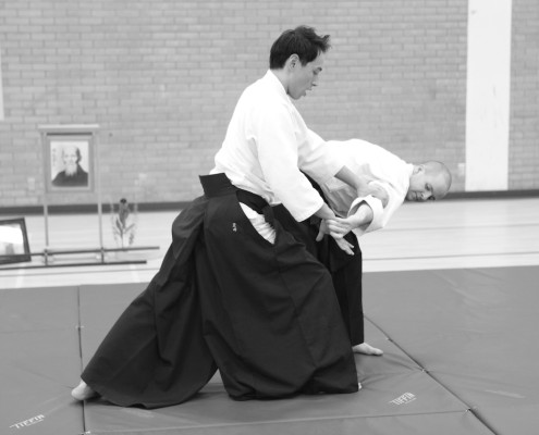 Aikido sensei Stephen Tatsuo Toyoda demonstrating martial arts technique.